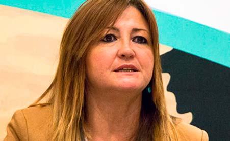 Dña. Marta Corella